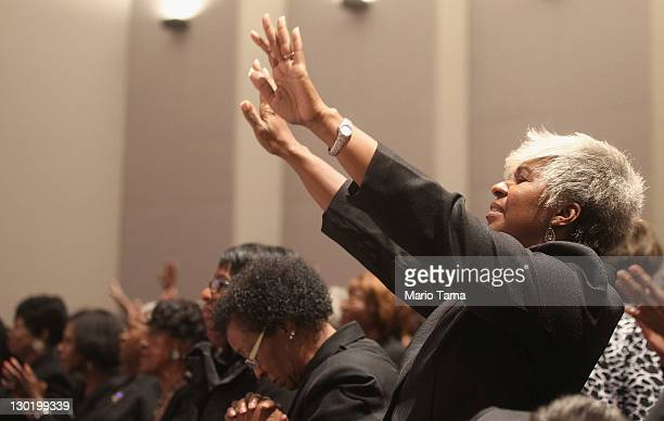 Mourners sing during the funeral of deceased civil rights icon Fred Shuttlesworth at Faith Chapel Christian Center 2on October 24 2011 in Birmingham...