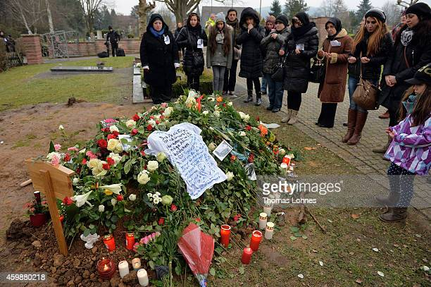 Mourners stand at the grave of Tugce Albayrak the 23yearold university student who died after she was attacked in a McDonald's restaurant parking lot...