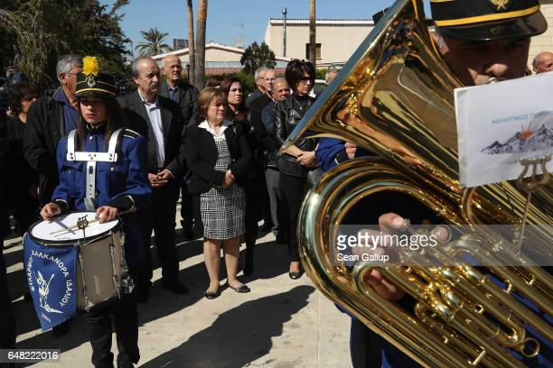 Mourners stand behind a brass band at the Orthodox funeral service for Georgiou Theodoulos Theodoulou on March 5 2017 in Pera Chorio Nisou Cyprus...
