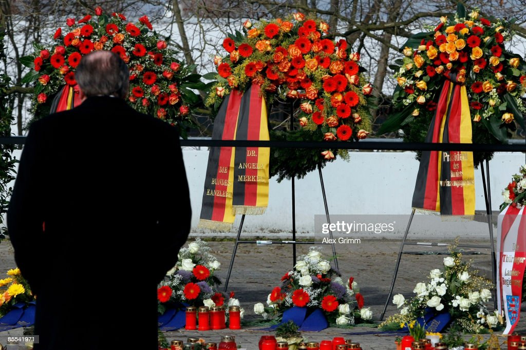 Mourners stand infront of flowers and candles outside Albertville high school on March 21 2009 in Winnenden near Stuttgart Germany 17 year old Tim...