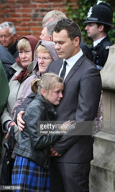 Mourners stand outside St Mary's Church as pall bearers carry the coffins of the Philpott children on June 22 2012 in Derby England Hundreds of...