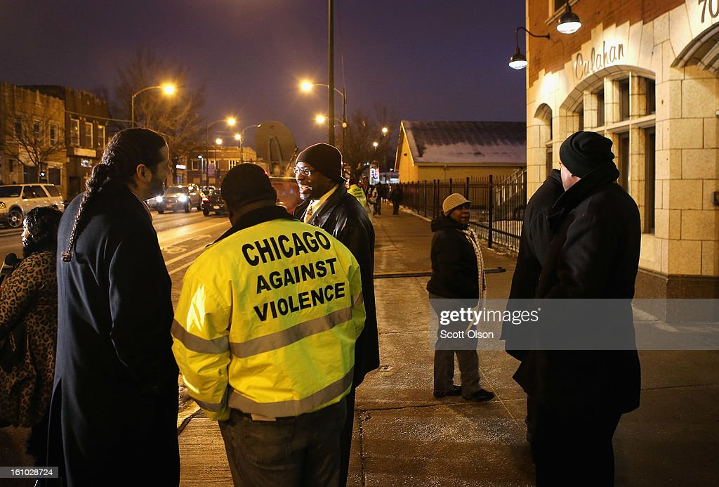 Mourners stand outside the Calahan Funeral Home during a wake for 15-year-old Hadiya Pendleton on February 8, 2013, in Chicago, Illinois. Hadiya was killed when a gunman opened fire on her and some friends as they stood under a shelter on a warm rainy afternoon in a park about a mile from President Obama's Chicago home. First lady Michelle Obama is expected to attend tomorrow's funeral with senior White House adviser Valerie Jarrett and Education Secretary Arne Duncan.