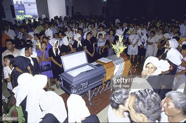 Mourners surrounding casket of slain Human Rights Commission president Herbert Anaya Sanabria