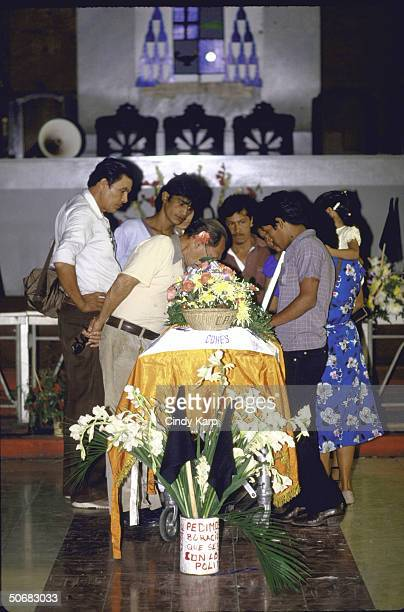 Mourners surrounding the coffin of assassinated Human Rights Comm president Herbert Anaya Sanabria