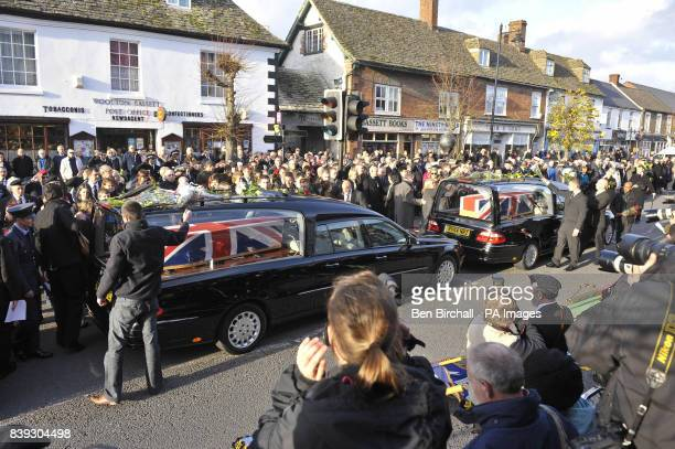 Mourners throw flowers onto the hearses at a repatriation through the Wiltshire town of Wootton Bassett as the bodies of Rifleman Philip Allen of 2nd...