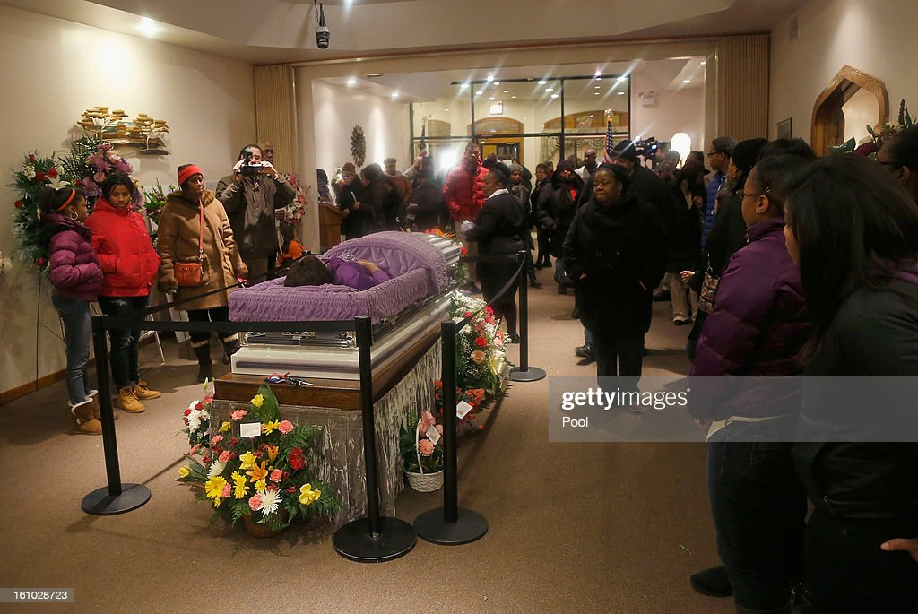 Mourners view the remains of 15-year-old Hadiya Pendleton at the Calahan Funeral Home February 8, 2013, in Chicago, Illinois. Hadiya was killed when a gunman opened fire on her and some friends as they stood under a shelter on a warm, rainy afternoon in a park about a mile from President Obama's Chicago home. First lady Michelle Obama is expected to attend tomorrow's funeral with senior White House adviser Valerie Jarrett and Education Secretary Arne Duncan.