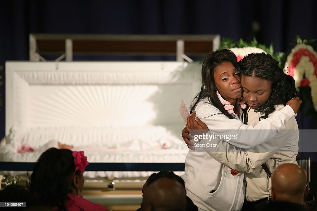 Mourners view the remains of six-month-old Jonylah Watkins prior to her funeral service at New Beginnings Church on March 19, 2013 in Chicago, Illinois. Watkins was shot, along with her father, while sitting on her father's lap in the family's minivan March 11. Jonylah died the following day. Her father is recovering from his wounds.
