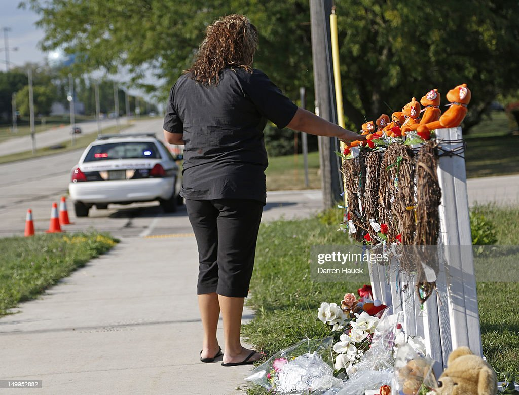 Mourners visit a make shift memorial near the Sikh Temple of Wisconsin August, 7, 2012 Oak Creek Wisconsin. A suspected gunman, 40-year-old Wade Michael Page, allegedly killed six people at the temple August 5, was shot to death by police at the scene. He was an army veteran and reportedly a former leader of a white supremacist heavy metal band. Three others were critically wounded in the attack.