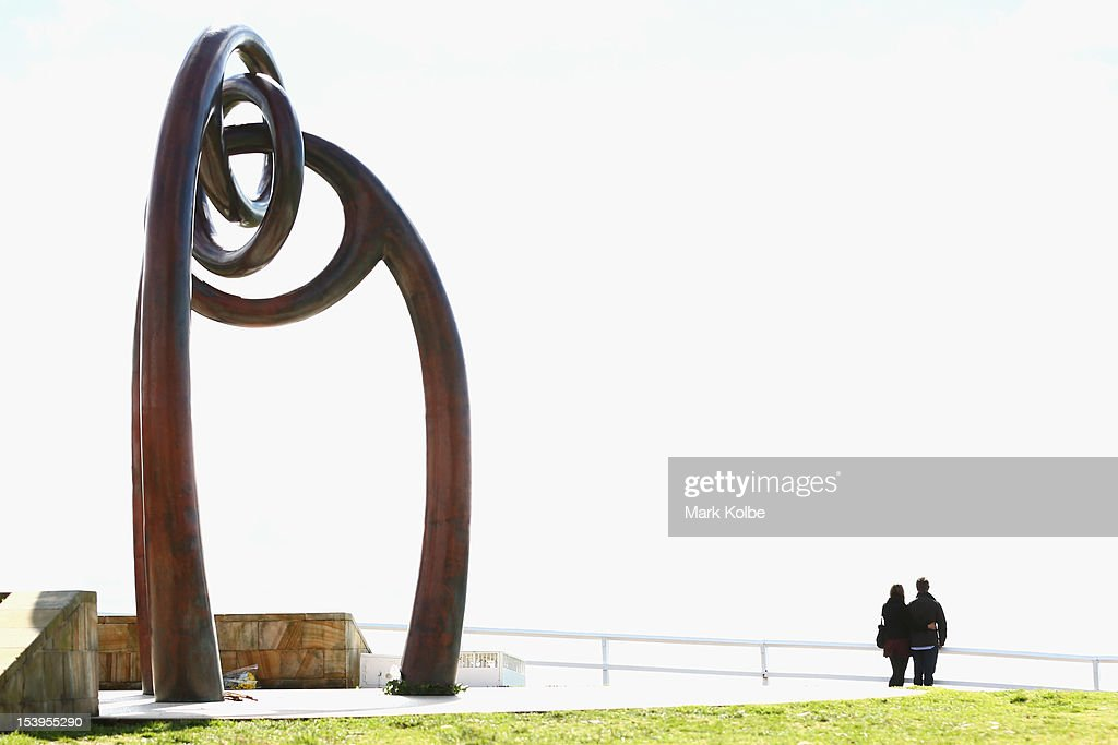 Mourners wait for the start of a memorial ceremony at Dolphin Point in Coogee in on October 12, 2012 in Sydney, Australia. The ceremony marks tenth anniversary of the 2002 Bali suicide bombs that killed 202 people including 88 Australians.