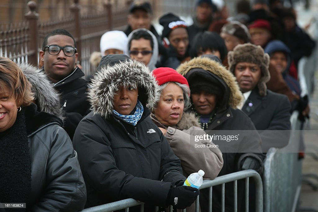 Mourners wait in line to get into the Greater Harvest M.B. Church for the funeral of 15-year-old Hadiya Pendleton on February 9, 2013, in Chicago, Illinois. Hadiya was killed on January 29, when a gunman opened fire on her and some friends while they were standing under a shelter on a warm rainy afternoon in a park about a mile from President Obama's Chicago home. First lady Michelle Obama attended the funeral with Senior White House Adviser Valerie Jarrett and Secretary of Education Arne Duncan.
