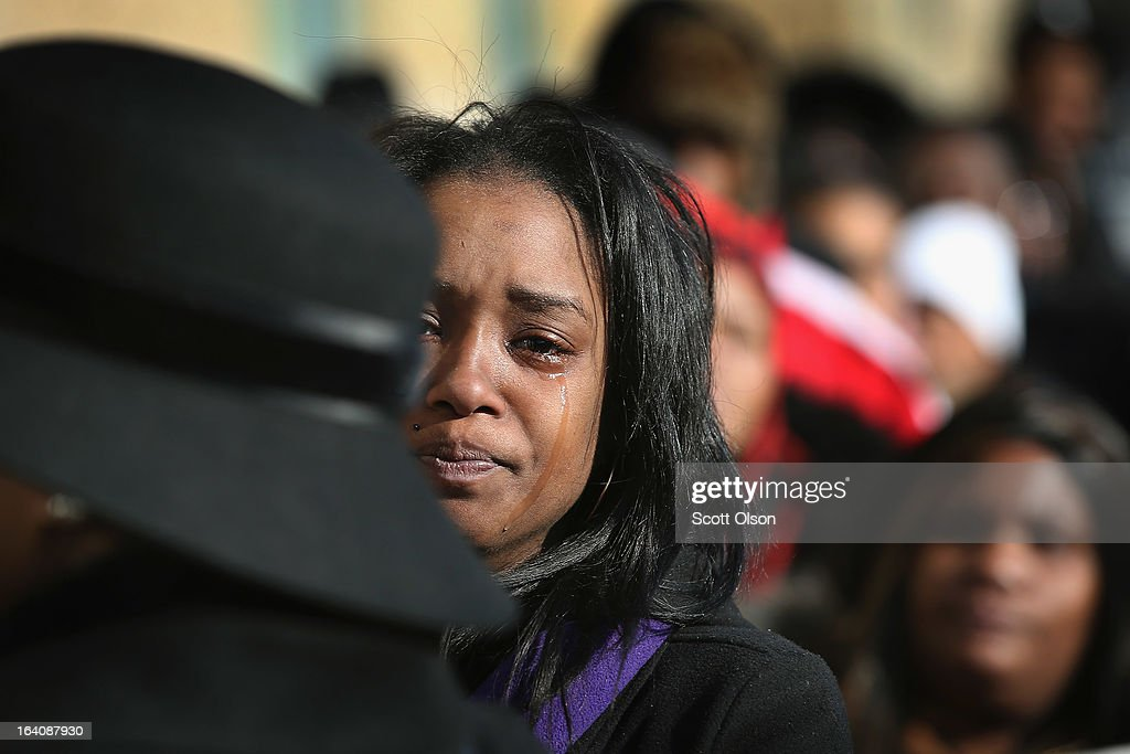 Mourners wait outside New Beginnings Church for the start of a funeral service for six-month-old Jonylah Watkins on March 19, 2013 in Chicago, Illinois. Watkins was shot, along with her father, while sitting on her father's lap in the family's minivan March 11. Jonylah died the following day. Her father is recovering from his wounds.
