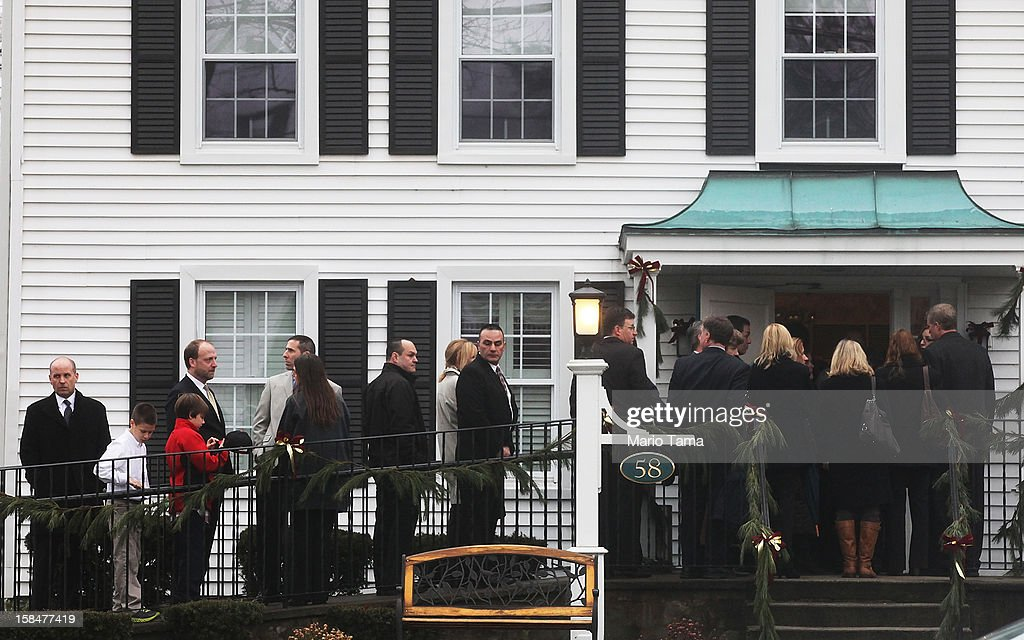 Mourners wait to enter Honan Funeral Home before the funeral for six-year-old Jack Pinto on December 17, 2012 in Newtown Connecticut. Pinto was one of the 20 students killed in the Sandy Hook Elementary School mass shooting.