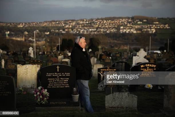 A mourners walks during Martin McGuinness' Funeral at the Derry City Cemetery on March 23 2017 in Londonderry Northern Ireland The funeral is held...
