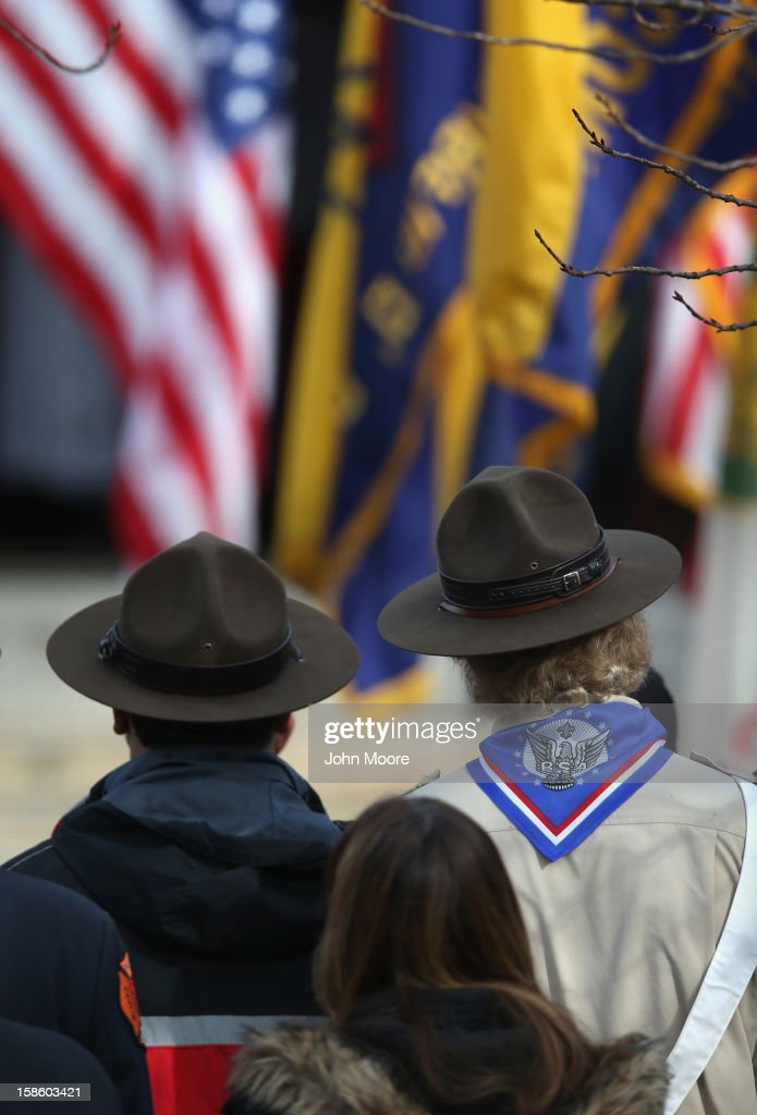 Mourners watch as a funeral procession passes by for Benjamin Wheeler, 6, at the Trinity Episcopal Church on December 20, 2012 in Newtown, Connecticut. Benjamin, a member of Tiger Scout Den 6, was killed when 20 children and six adults were massacred at Sandy Hook Elementary School last Friday.