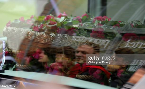 Mourners watch as the coffin of Manchester Attack victim Saffie Roussos arrives for her funeral at Manchester Cathedral on July 26 2017 in Manchester...