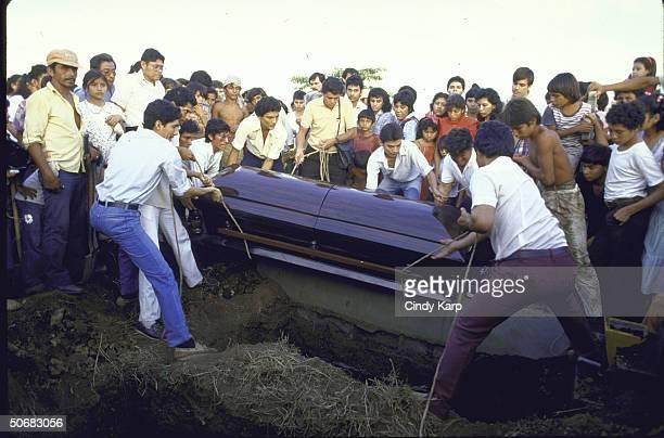 Mourners watching burial of slain Human Rights Commission president Herbert Anaya Sanabria