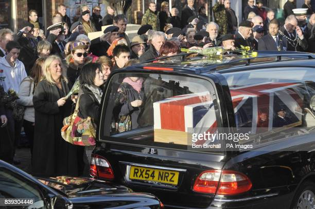Mourners weep at a repatriation through the Wiltshire town of Wootton Bassett as the bodies of Rifleman Philip Allen of 2nd Battalion The Rifles and...