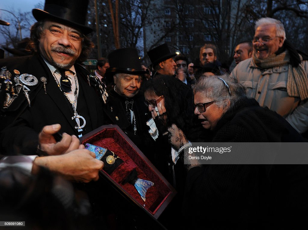 Mourners weep for the dead sardine during the Burial of the Sardine procession on February 10, 2016 in Madrid, Spain. The Sardine procession is a centuries-old Spanish tradition made famous by a painting by Spanish artist Francisco de Goya called 'El Entierro de La Sardina'. The mourners hold a mock funeral procession mourning the end of Carnival through the heart of old 'Castizo' Madrid visiting and enjoying the wines and tapas of local taverns.