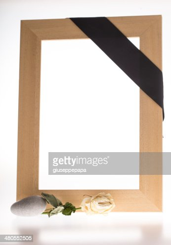 mourning frame with withered rose : Stock Photo