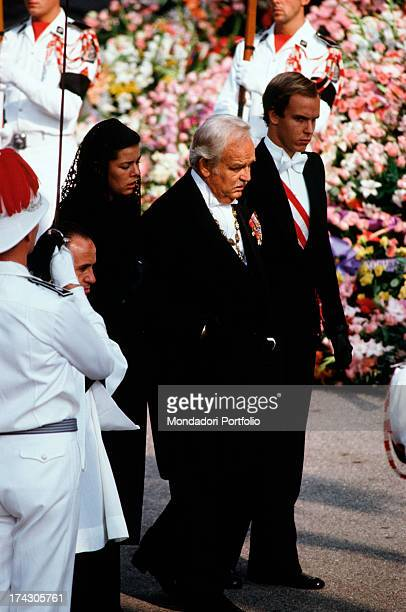 Mourning official portrait of the Grimaldi family commemorating the death of Grace of Monaco from the left Caroline Prince Ranieri III Princess Grace...