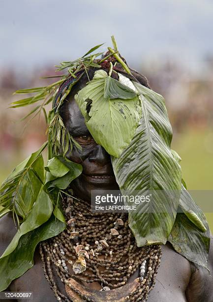 Mourning woman from Highlands in Papua New Guinea She has put some sump oil on her body