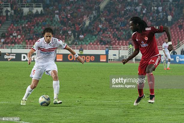 Mourtada Serigne Fall of Wydad Casablanca and Ibrahim Salah of Zamalek vie for the ball during the semifinal match of CAF Champions League between...