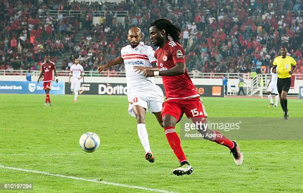Mourtada Serigne Fall of Wydad Casablanca and Shikabala of Zamalek vie for the ball during the semifinal match of CAF Champions League between Wydad...