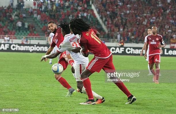 Mourtada Serigne Fall of Wydad Casablanca and Stanley Ohawuchi of Zamalek vie for the ball during the semifinal match of CAF Champions League between...