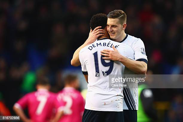 Mousa Dembele and Kevin Wimmer of Tottenham Hotspur celebrate victory after the Barclays Premier League match between Tottenham Hotspur and AFC...