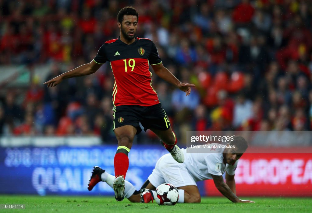 Mousa Dembele of Belgium gets past the tackle from Joseph Chipolina of Gibraltar during the FIFA 2018 World Cup Qualifier between Belgium and Gibraltar at Stade Maurice Dufrasne on August 31, 2017 in Liege, Belgium.