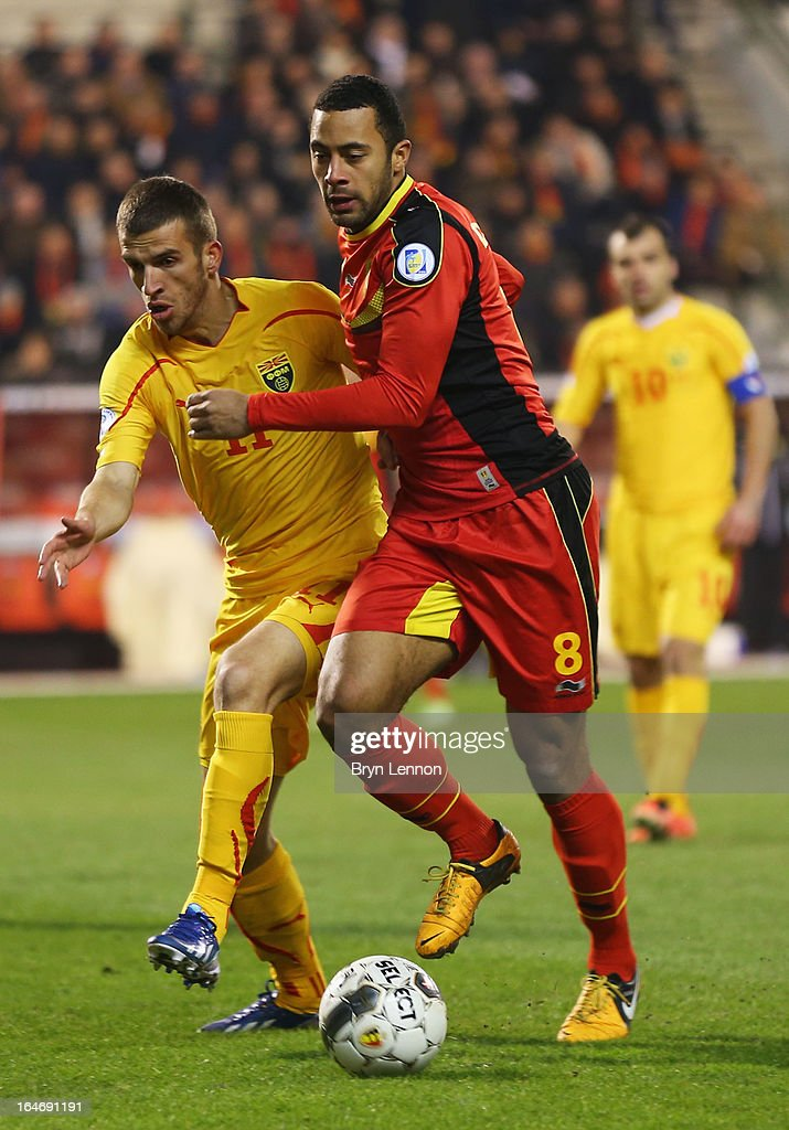 Mousa Dembele of Belgium takes on Ferhan Hasani of Macedonia during the FIFA 2014 World Cup Qualifier Group A match between Belgium and Macedonia at Stade Roi Baudouis on March 26, 2013 in Brussels, Belgium.