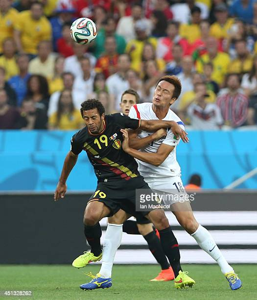 Mousa Dembele of Belgium vies with Ji DongWon of Korea during the 2014 FIFA World Cup Brazil Group H match between Korea Republic and Belgium at the...