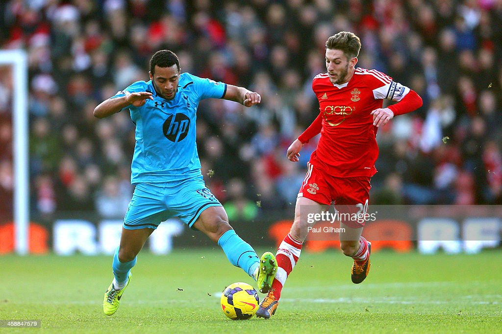 Mousa Dembele of Spurs and Adam Lallana of Southampton battle for possession during the Barclays Premier League match between Southampton and Tottenham Hotspur at St Mary's Stadium on December 22, 2013 in Southampton, England.