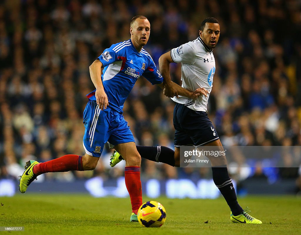 Mousa Dembele of Spurs and David Meyler of Hull City compete for the ball during the Barclays Premier League match between Tottenham Hotspur and Hull City at White Hart Lane on October 27, 2013 in London, England.