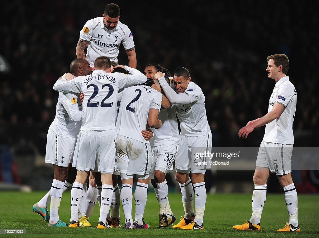 Mousa Dembele of Spurs celebrates his goal with team mates during the UEFA Europa League Round of 32, second leg match between Olympique Lyonnais and Tottenham Hotspur FC at Stade de Gerland on February 21, 2013 in Lyon, France.