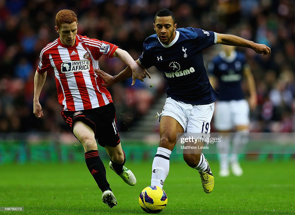 Mousa Dembele of Tottenham holds off <a gi-track='captionPersonalityLinkClicked' href=/galleries/search?phrase=Jack+Colback&family=editorial&specificpeople=4940395 ng-click='$event.stopPropagation()'>Jack Colback</a> of Sunderland during the Barclays Premier League match between Sunderland and Tottenham Hotspur at Stadium of Light on December 29, 2012 in Sunderland, England.