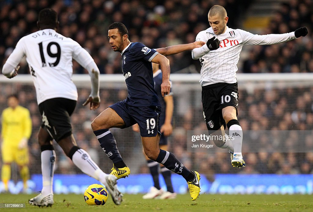 Mousa Dembele of Tottenham holds off <a gi-track='captionPersonalityLinkClicked' href=/galleries/search?phrase=Mladen+Petric&family=editorial&specificpeople=699883 ng-click='$event.stopPropagation()'>Mladen Petric</a> of Fulham during the Barclays Premier League match between Fulham and Tottenham Hotspur at Craven Cottage on December 1, 2012 in London, England.