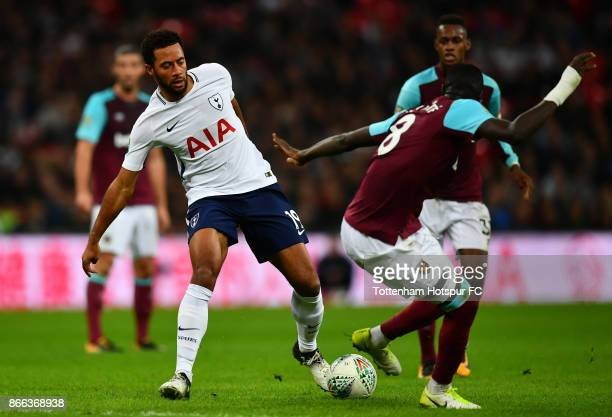 Mousa Dembele of Tottenham Hotspur and Cheikhou Kouyate of West Ham United in action during the Carabao Cup Fourth Round match between Tottenham...