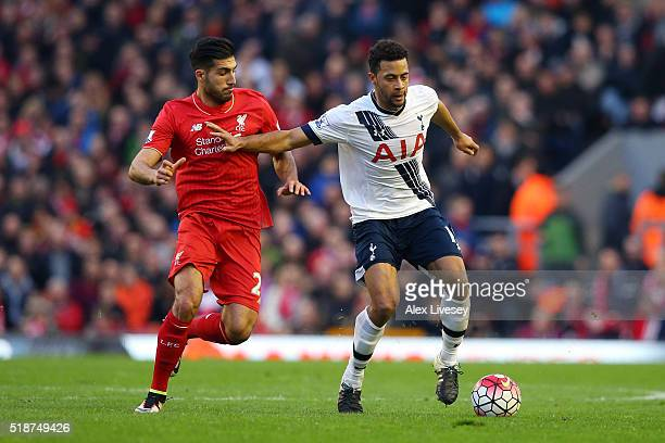 Mousa Dembele of Tottenham Hotspur and Emre Can of Liverpool compete for the ball during the Barclays Premier League match between Liverpool and...