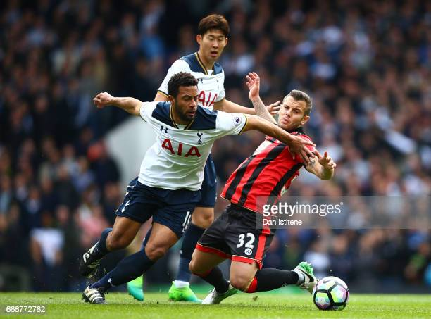 Mousa Dembele of Tottenham Hotspur and Jack Wilshere of AFC Bournemouth battle for possession during the Premier League match between Tottenham...