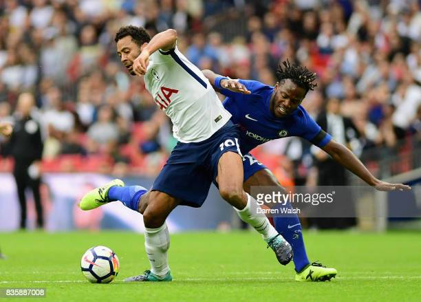 Mousa Dembele of Tottenham Hotspur and Michy Batshuayi of Chelsea battle for possession during the Premier League match between Tottenham Hotspur and...