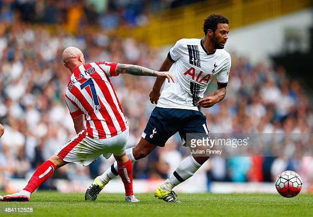 Mousa Dembele of Tottenham Hotspur and Stephen Ireland of Stoke City compete for the ball during the Barclays Premier League match between Tottenham...