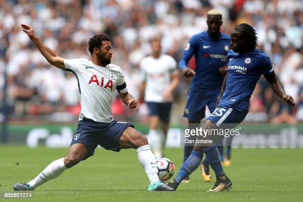 Mousa Dembele of Tottenham Hotspur and Victor Moses of Chelsea battle for possession during the Premier League match between Tottenham Hotspur and...