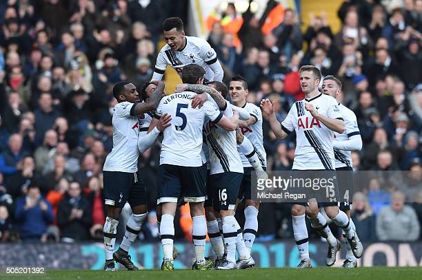 Mousa Dembele of Tottenham Hotspur celebrates scoring his team's second goal with his team mates during the Barclays Premier League match between...