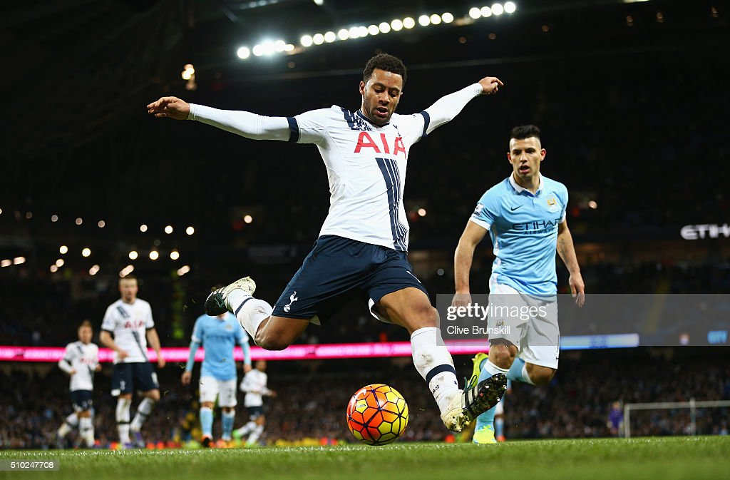 Mousa Dembele of Tottenham Hotspur clears with Sergio Aguero of Manchester City during the Barclays Premier League match between Manchester City and Tottenham Hotspur at Etihad Stadium on February 14, 2016 in Manchester, England.