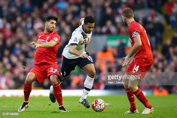 Mousa Dembele of Tottenham Hotspur competes for the ball against Emre Can and Jordan Henderson of Liverpool compete for the ball during the Barclays...