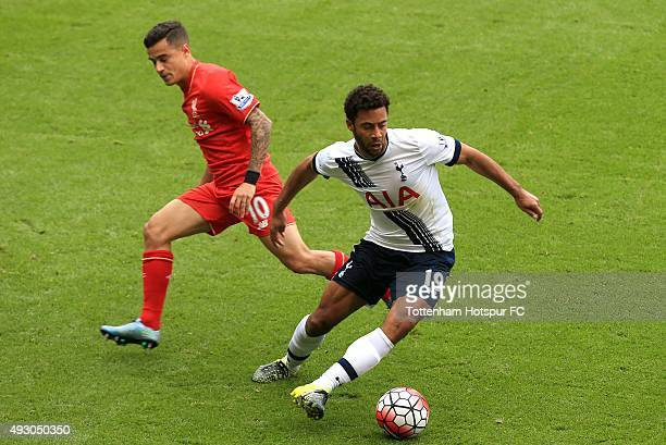 Mousa Dembele of Tottenham Hotspur competes for the ball with Philippe Coutinho of Liverpool during the Barclays Premier League match between...