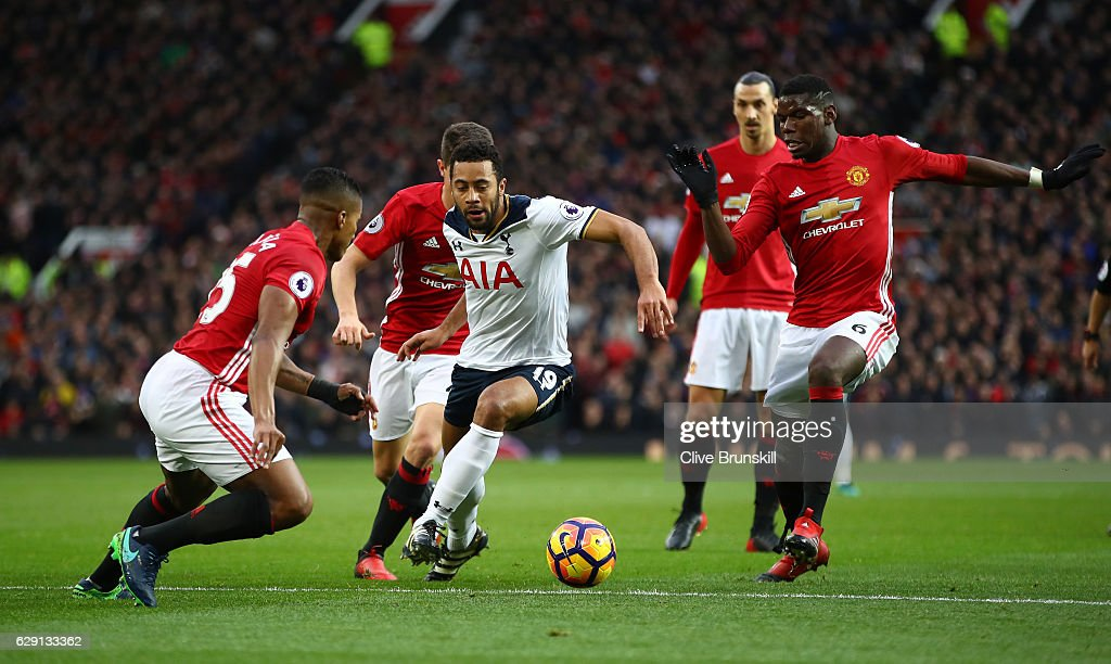 Mousa Dembele of Tottenham Hotspur controls the ball under pressure of Manchester United defense during the Premier League match between Manchester United and Tottenham Hotspur at Old Trafford on December 11, 2016 in Manchester, England.