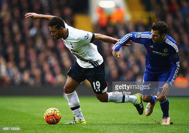 Mousa Dembele of Tottenham Hotspur evades Cesc Fabregas of Chelsea during the Barclays Premier League match between Tottenham Hotspur and Chelsea at...