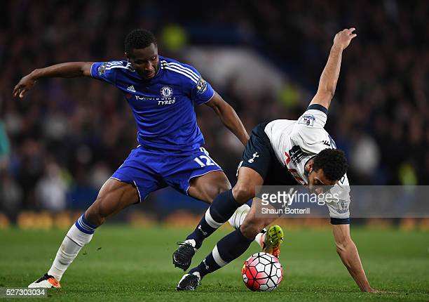 Mousa Dembele of Tottenham Hotspur is brought down by John Mikel Obi of Chelsea during the Barclays Premier League match between Chelsea and...